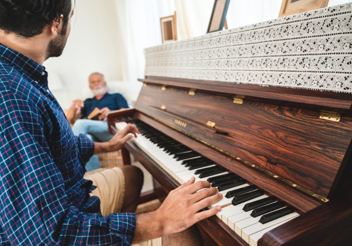 elderly-dad-and-son-are-playing-music-at-home-rela-Q38DMFCweb